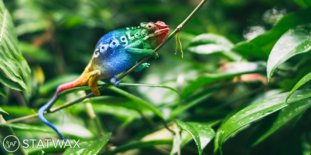 yellow, red, blue, and green colored chameleon on a green leaf on a background of green leaves